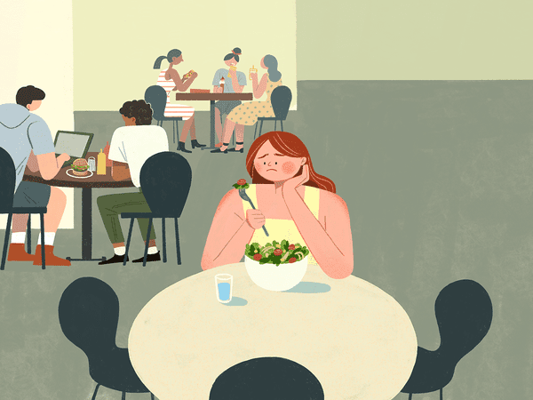 College students in the school cafeteria. One student should appear to be picking at their food, not really eating it, looking low and sad.