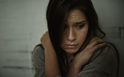 A woman with schizophrenia looking scared.