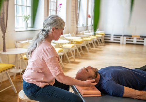 Woman practicing somatic movement in her health studio
