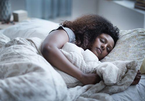 Sleeping in bed.