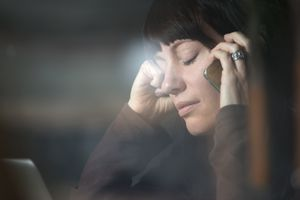 Woman talking on cell phone, looking sad