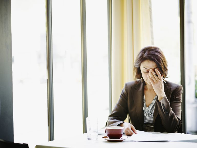 stressed woman at table