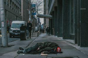 Man lying on the street.