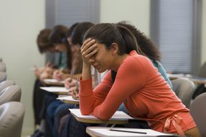 Girl looks anxious while taking test.