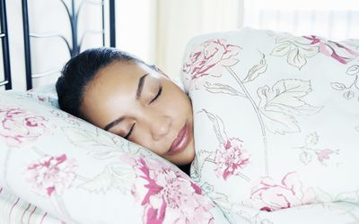 Woman asleep and dreaming