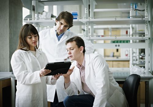 Researchers working on a replication study