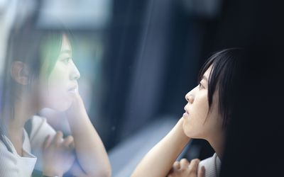Woman thinking deeply by the window