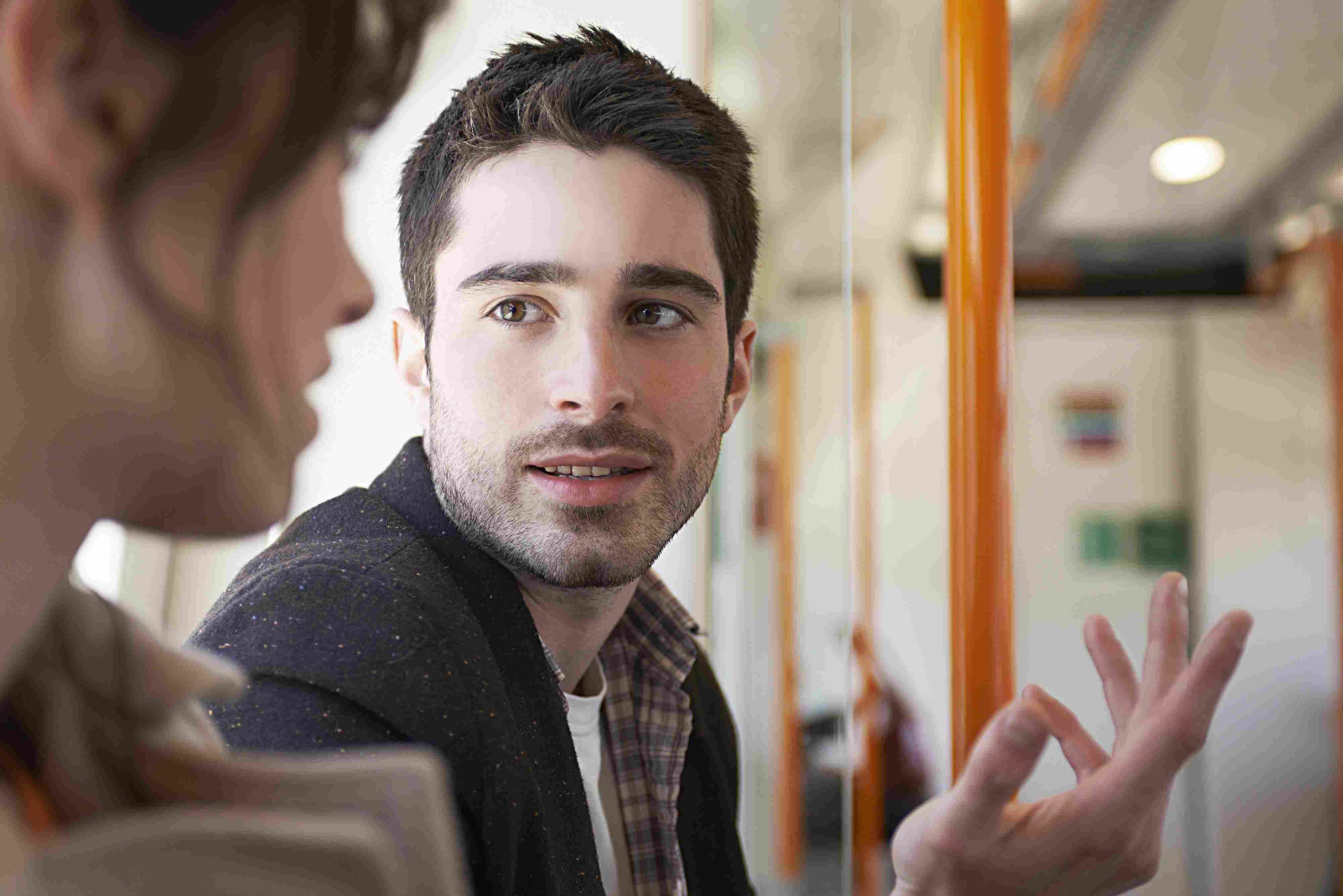 Man and woman talking on subway