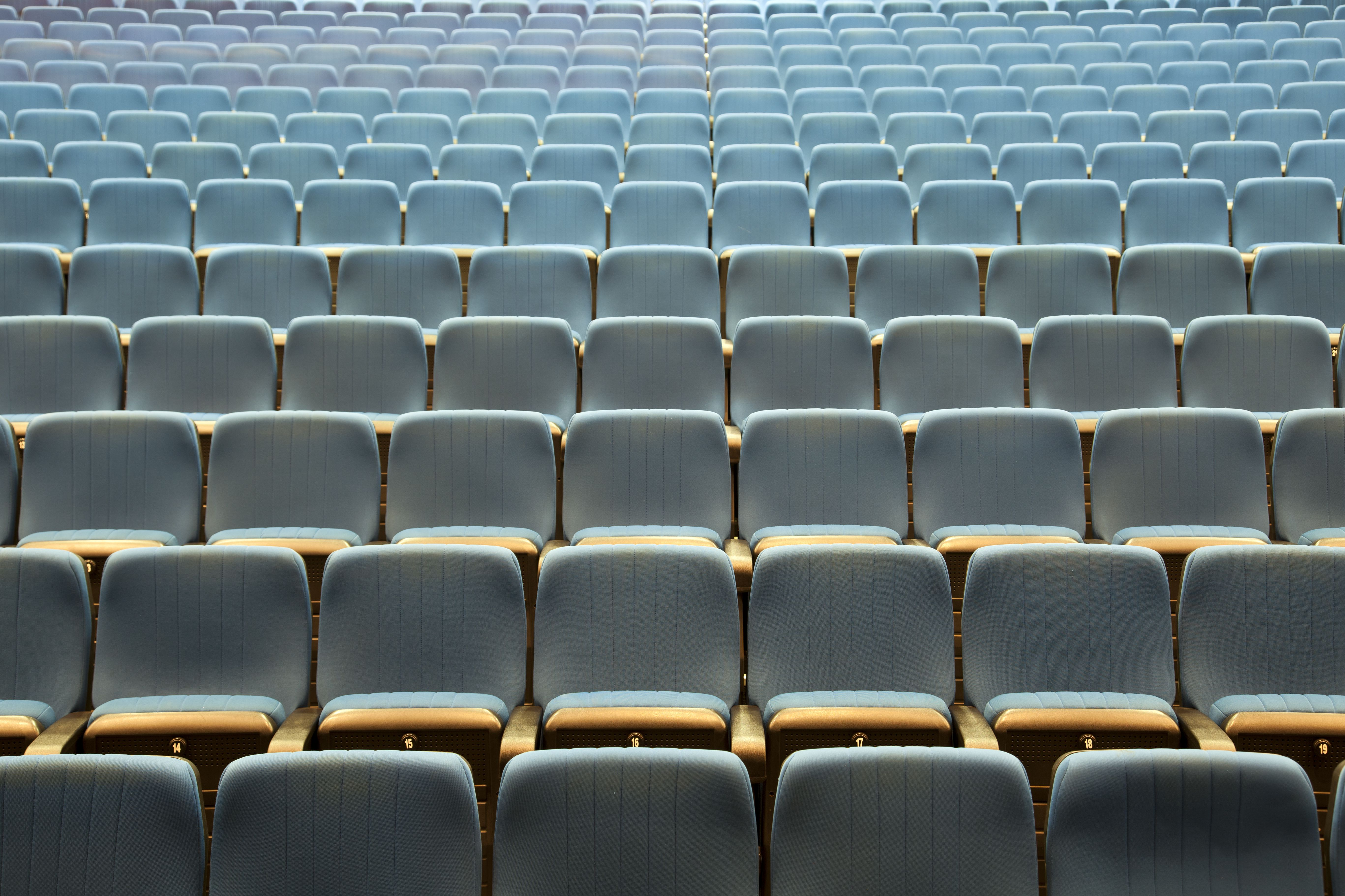 Empty rows of seats in an auditorium