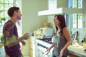 man and woman arguing in the kitchen