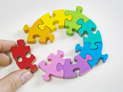 Person putting together puzzle pieces