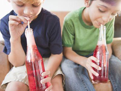 children drinking soda