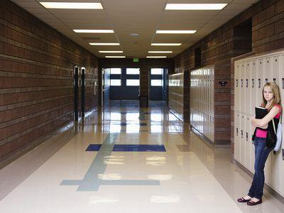 Teenage Girl in Empty School Hallway