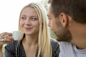 Smiling woman admired by her boyfriend