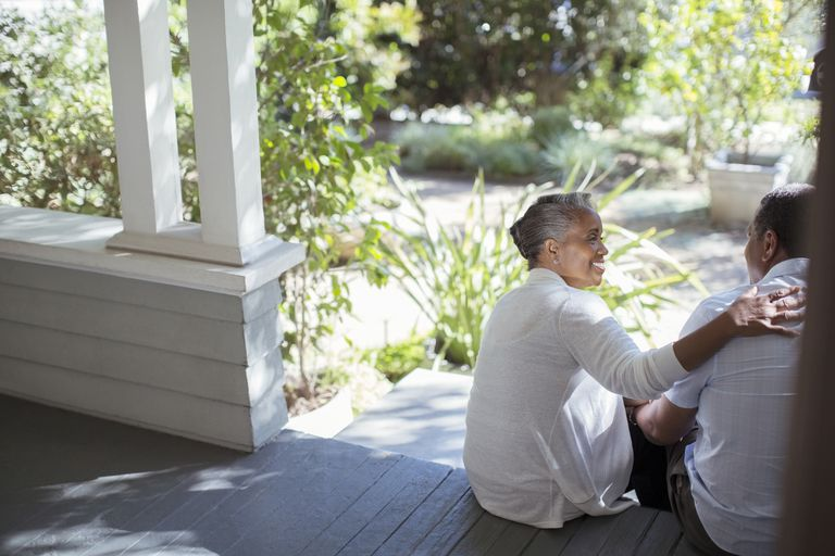 Senior couple hugging on porch