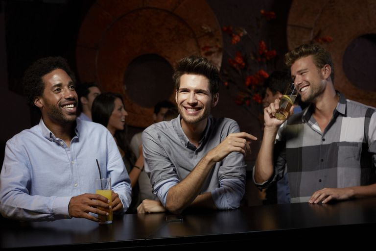 Models pose as male friends drinking alcohol