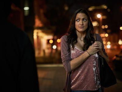 scared woman walking down street at night