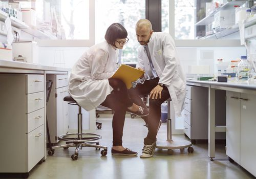 Two researchers talking