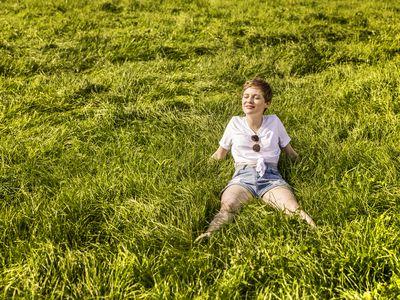 Woman in field enjoying sunlight