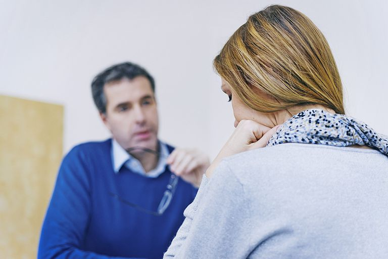 therapist talking to woman