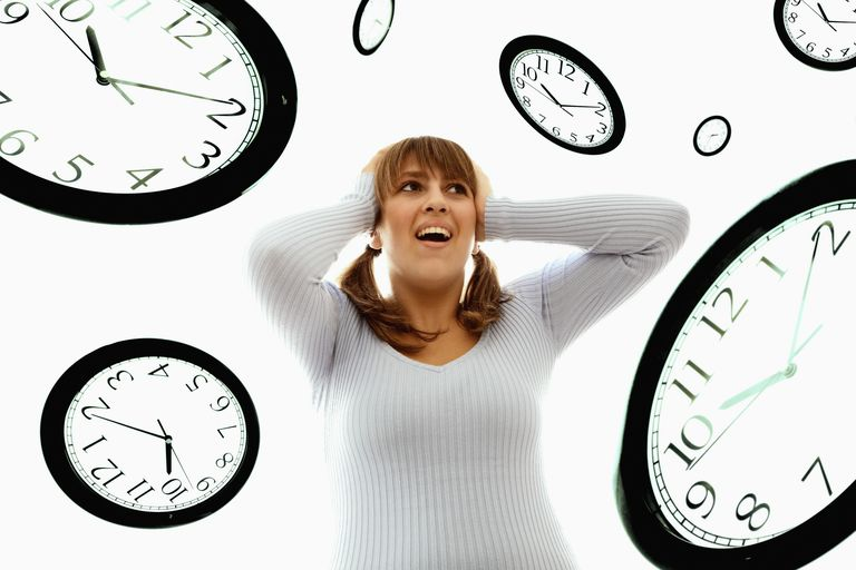 Clocks floating around an upset woman with her hands on her head