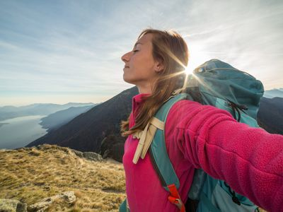 woman feeling free at top of mountain