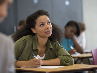 woman thinking while taking exam