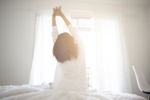 A woman waking up in the morning
