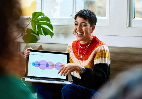 Cheerful young woman with laptop smiling