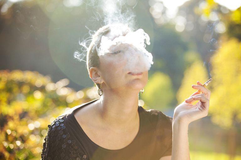 cigarette smoke in woman's face