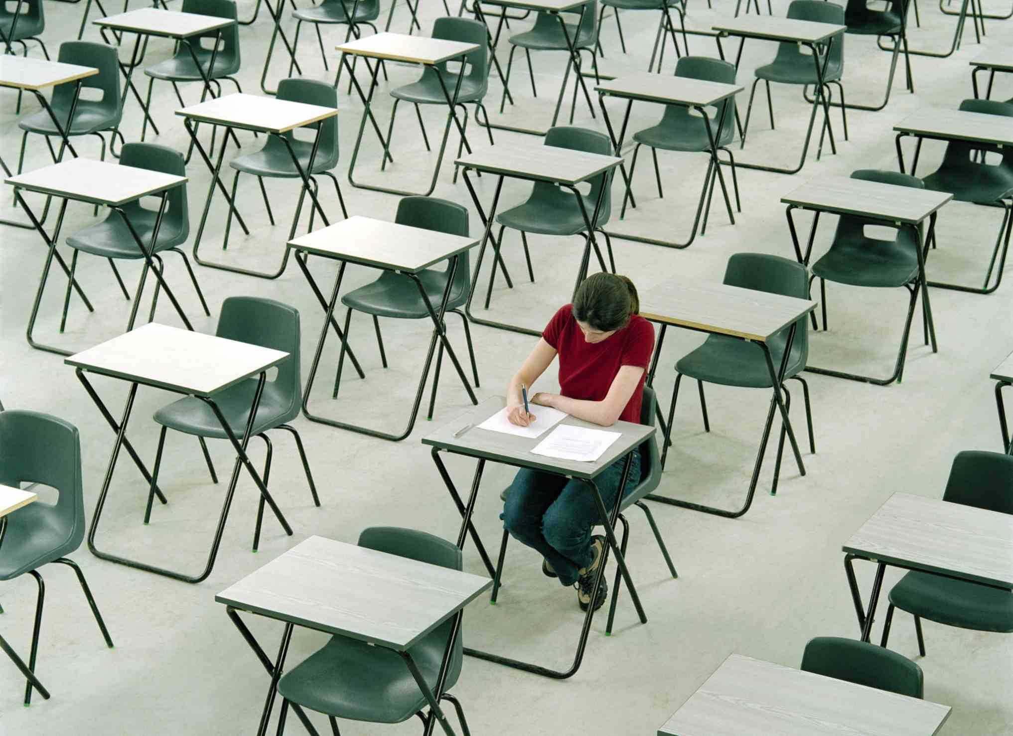 Student sitting at a desk among many empty desks
