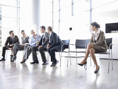 Woman sitting alone separate from group