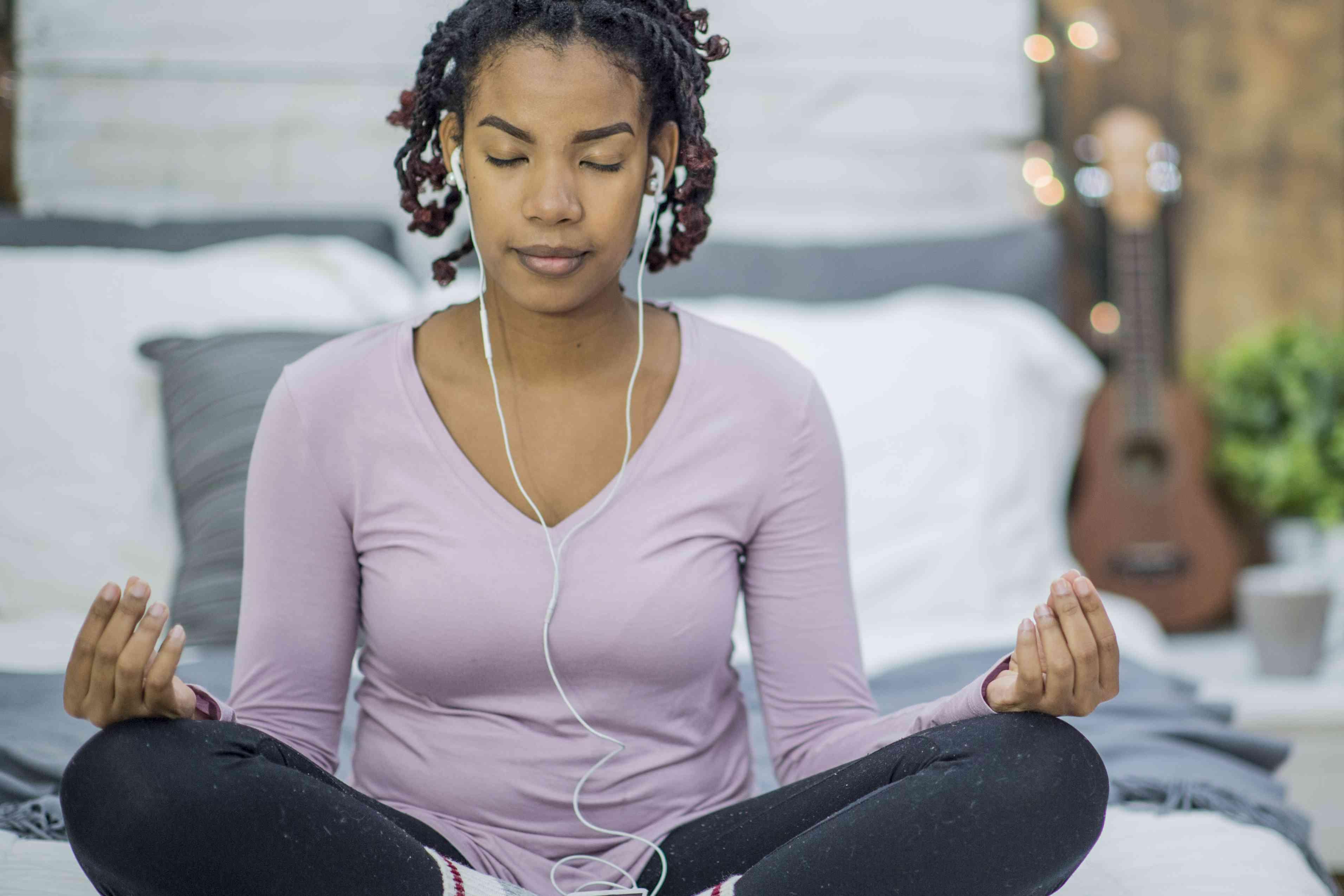 Woman meditating wearing headphones
