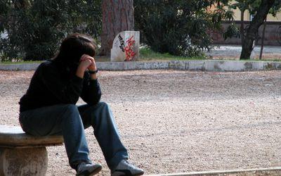 sad-person-on-a-park-bench.jpg