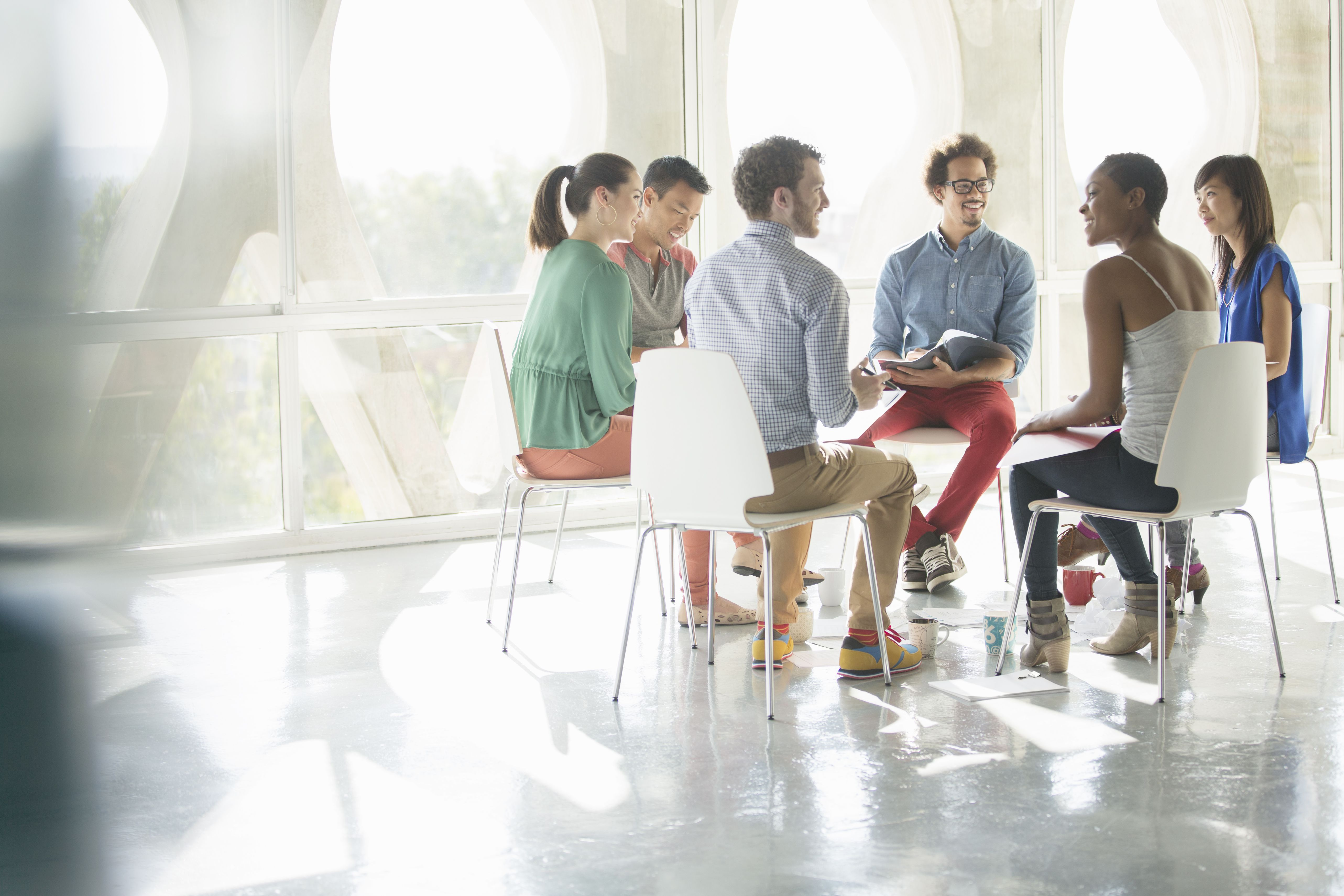 Business people meeting in circle of chairs