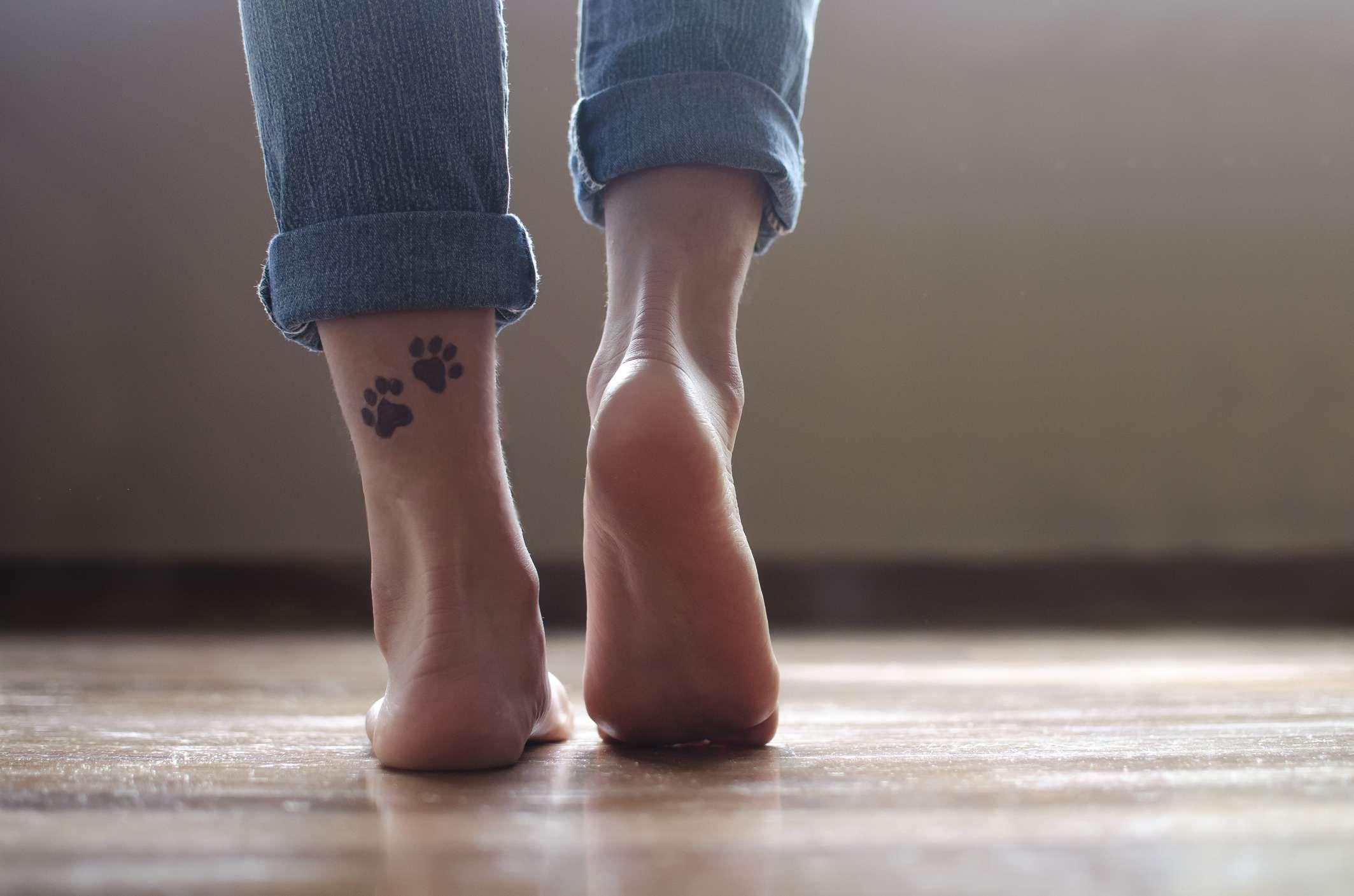 Leg with paw print tattoo