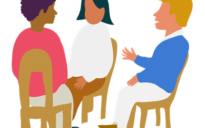 Three people talking in group therapy