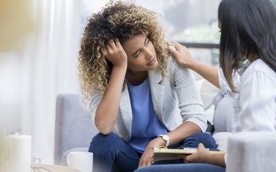 A woman talking to a counselor.