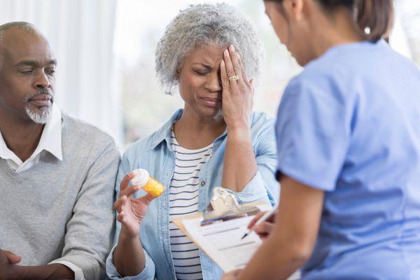 Woman having negative medication side effects