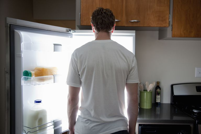 Man standing in front of a refrigerator