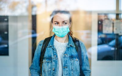 Woman wearing a surgical mask outdoors