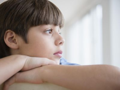 USA, New Jersey, Jersey City, Portrait of pensive boy (8-9)