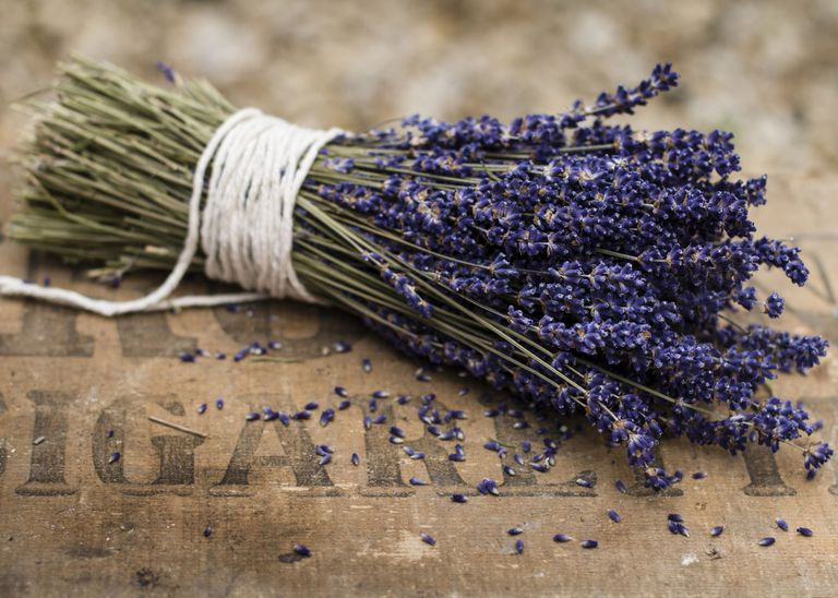 A bunch of lavender on a wooden tabletop