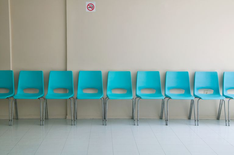 row of empty chairs in waiting room