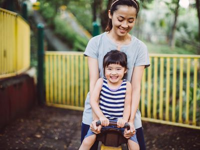 happy child with mother at a playground