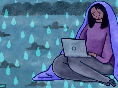 Illustration of sad woman on laptop looking for depression resources online