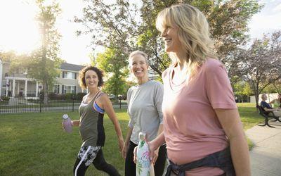 Smiling senior women walking in a sunny park