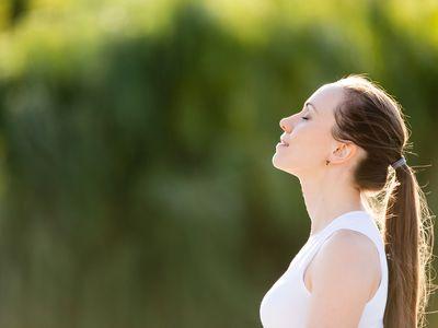 Sporty beautiful smiling young woman relaxing