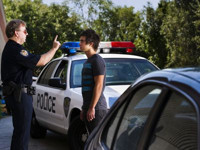 Officer giving roadside sobriety test to man