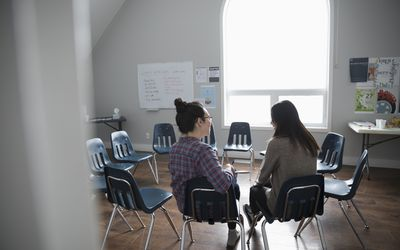 Women talking in circle at support group in community center
